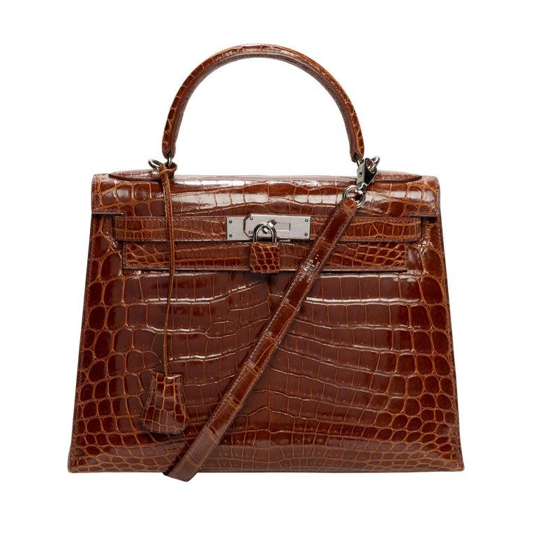 "Hermès Kelly 28 handbag with strap in crocodile ""havane"", Silver hardware For Sale"