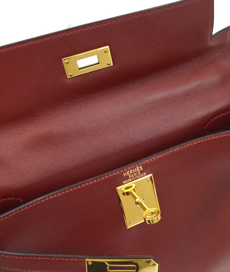 Leather Gold tone hardware Leather lining Turn-lock closure Made in France Date code present Top Handle drop 3.5