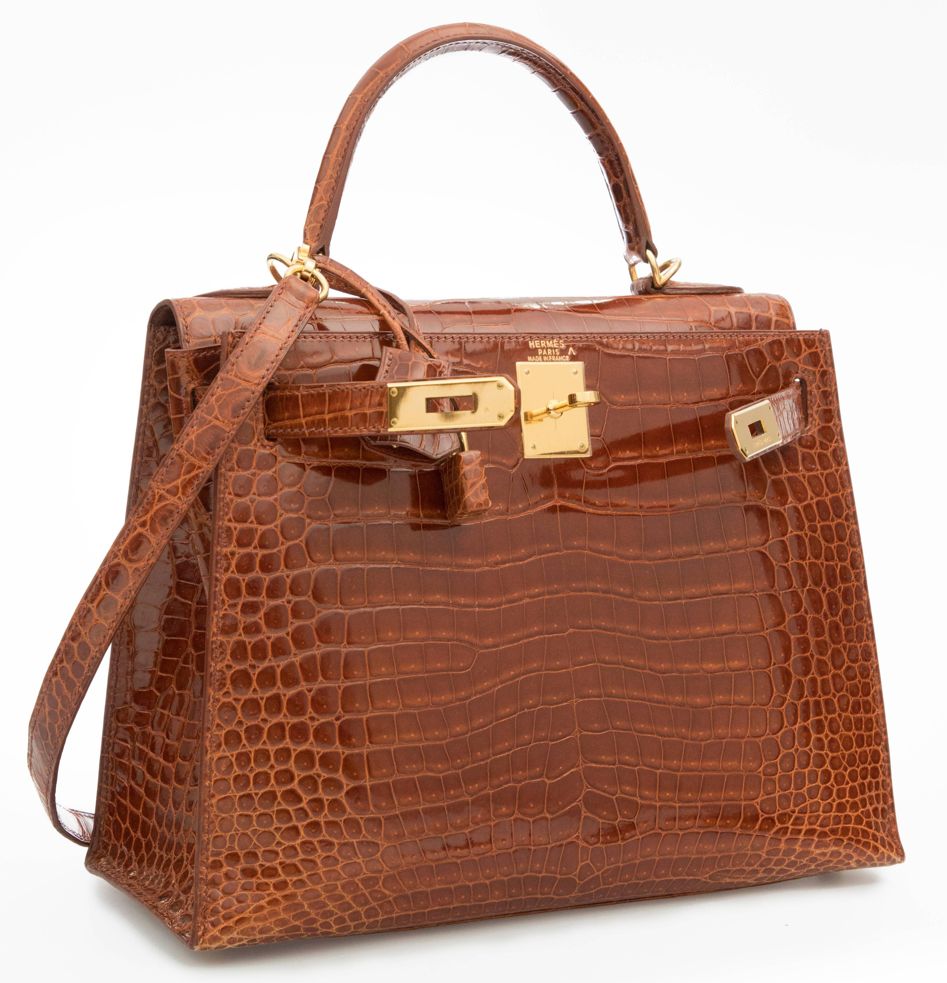 3565597a2539 ... new zealand hermes kelly 28 miel shiny porosus crocodile with gold  hardware. the overall condition