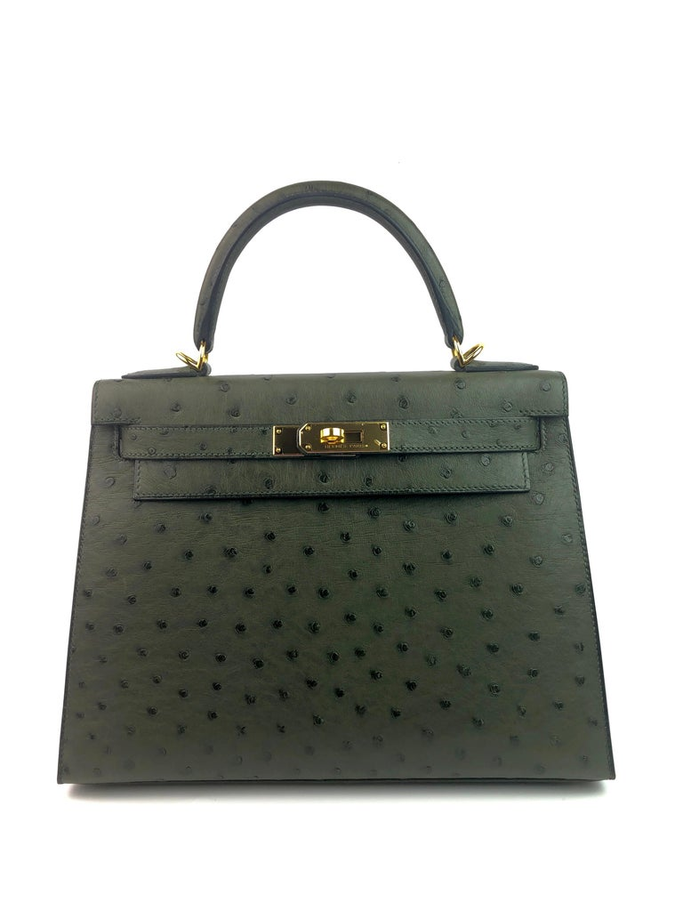 Hermes Kelly 28 Vert Veronese Green Gold Hardware With Plastic on Hardware. 2015 T STAMP. Almost Like New Condition, Plastic On Hardware and 2 feet, perfect corners and perfect structure.   Shop with confidence from Lux Addicts. Authenticity
