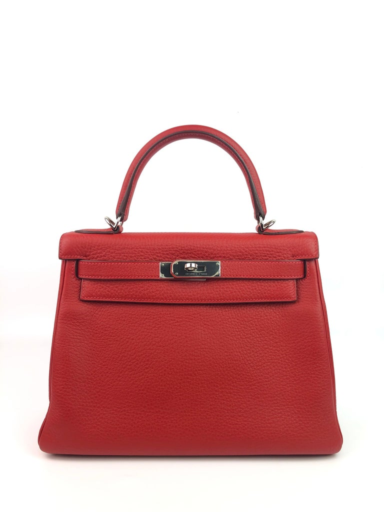 Hermes Kelly 28 Rouge Casaque Red Palladium Hardware . 2012 P STAMP. Excellent Condition, Plastic On Hardware, perfect corners and excellent structure.   Shop with confidence from Lux Addicts. Authenticity guaranteed!