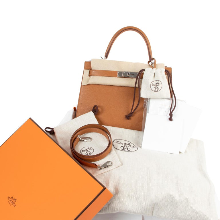 Hermès Kelly 28 Verso Gold Ambre Epsom PHW If you're looking for that all-time classic bag with a cool and unique touch, this Hermès Kelly 28 Verso Gold Ambre Epsom PHW is the one for you. Brand new and fresh from the boutique, this beauty comes in