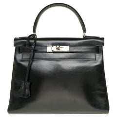 Hermès Kelly 28cm shoulder bag with strap in black calfskin and silver hardware