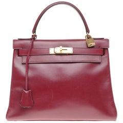Hermès Kelly 28cm retourné handbag in burgundy box calfskin with Gold hardware