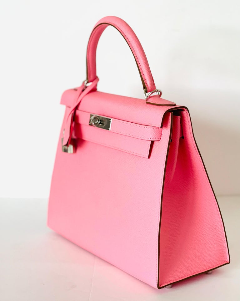 Hermès  Kelly 28 cm  Rose Confetti, retired color that has been brought back for a limited time Epsom Leather, Sellier Style Tonal topstich  Palladium Hardware Top handle with removable shoulder strap      New, never worn Storefresh with plastic on