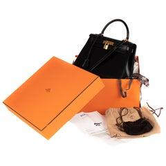 Hermès Kelly 28cm sellier with strap handbag in black calfskin Gold hardware