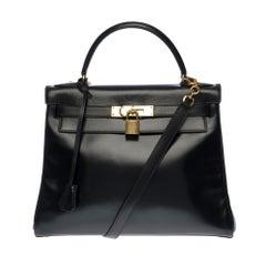 Hermès Kelly 28cm shoulder bag with strap in black calfskin and gold hardware