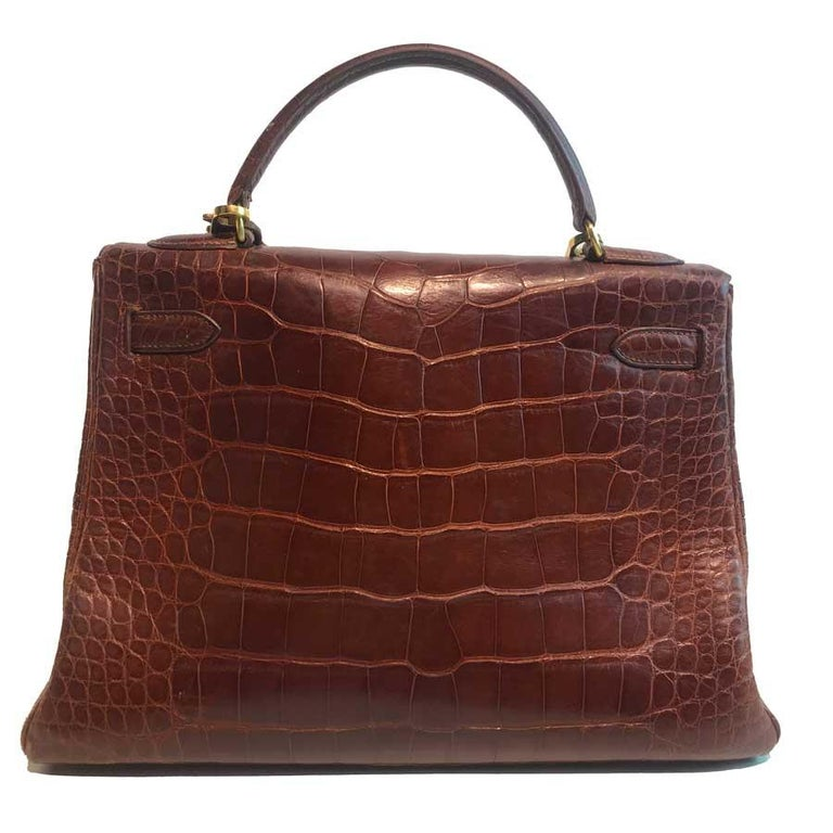 Brown HERMES Kelly 32 Alligator And Golden Jewelry For Sale
