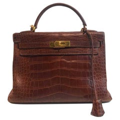 HERMES Kelly 32 Alligator And Golden Jewelry