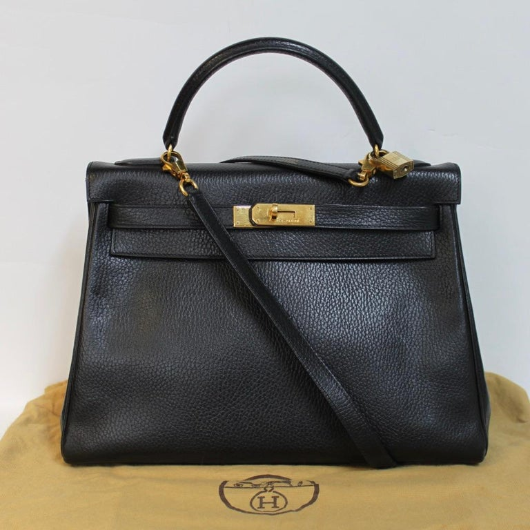 Iconic and timeless Hermes Kelly 32 in black leather with gold hardware. It comes with dustbag and certificate of authenticity.  Dimensions: 32 x  24 x 12 cm 12,5 x 9,4 x 5 inches  The bag has some small signs of wear. There are only a few little