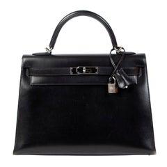 Hermès Kelly 32 Black Boxcalf PHW + Strap