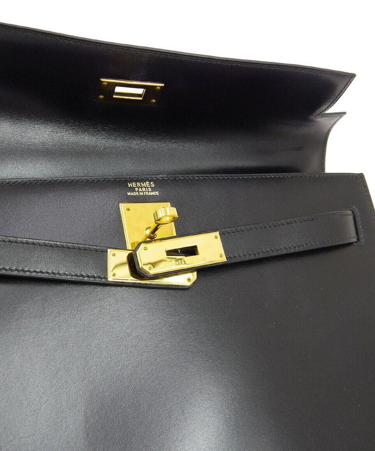 Hermes Kelly 32 Black Leather Gold Top Handle Satchel Evening Shoulder Bag  Leather Gold tone hardware Leather lining Date code present Made in France Handle drop 3.5