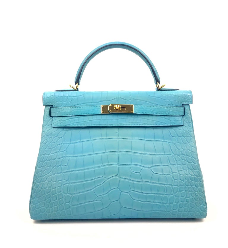 HERMES KELLY 32 BLUE ATOLL MATTE ALLIGATOR MISSISSIPPIEN CROCODILE. Pristine Condition, Plastic on Hardware. T Stamp 2015.  Shop with Confidence from Lux Addicts. Authenticity Guaranteed!