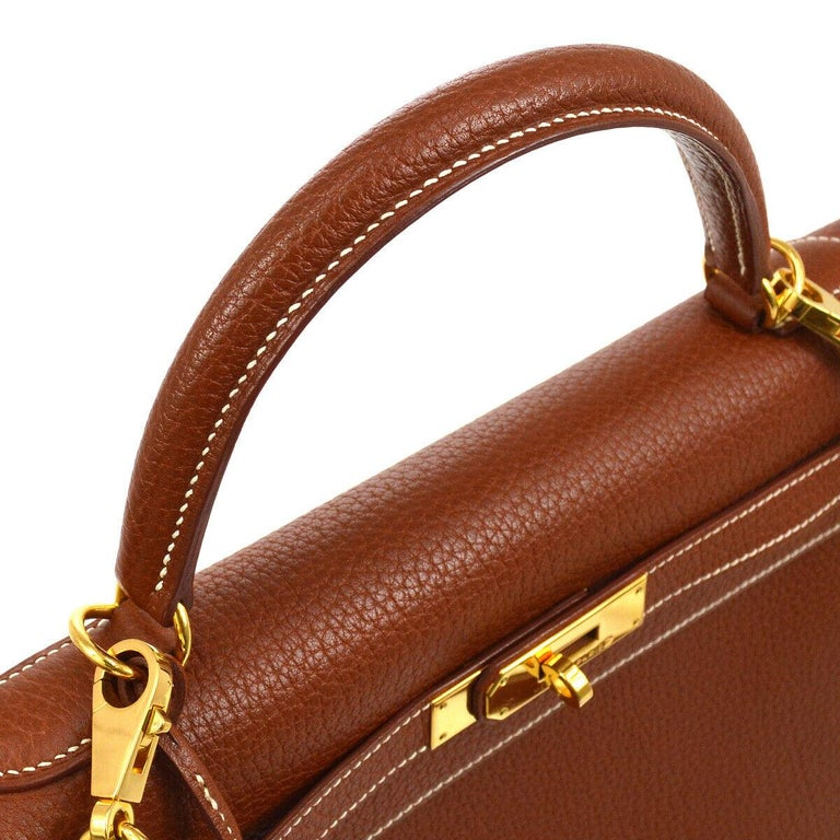 Hermes Kelly 32 Cognac Brown Leather Gold Top Handle Satchel Evening Shoulder Tote Bag  Leather Gold tone hardware Leather lining Date code present Made in France Handle drop 3.5