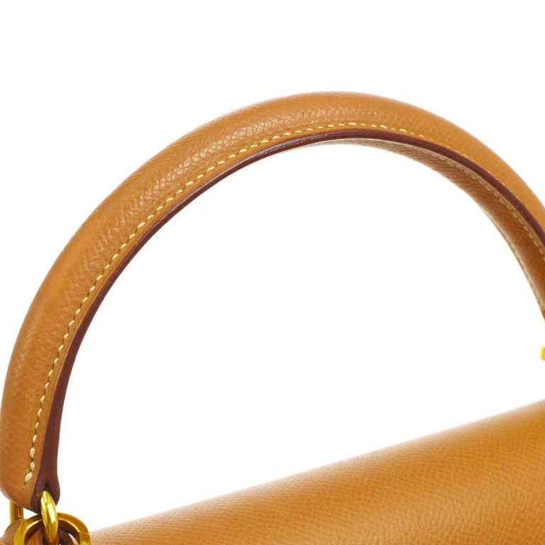 Hermes Kelly 32 Cognac Tan Leather Gold Top Handle Satchel Shoulder Bag  Leather Gold tone hardware Leather lining Date code present Made in France Handle drop 3.5