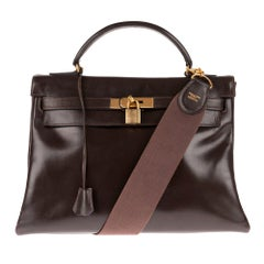 Hermès Kelly 32 handbag in brown calfskin leather with strap and golden hardware