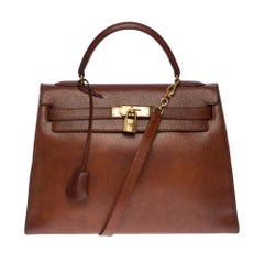 Hermès Kelly 32 handbag with strap in Brown Pecari leather, GHW