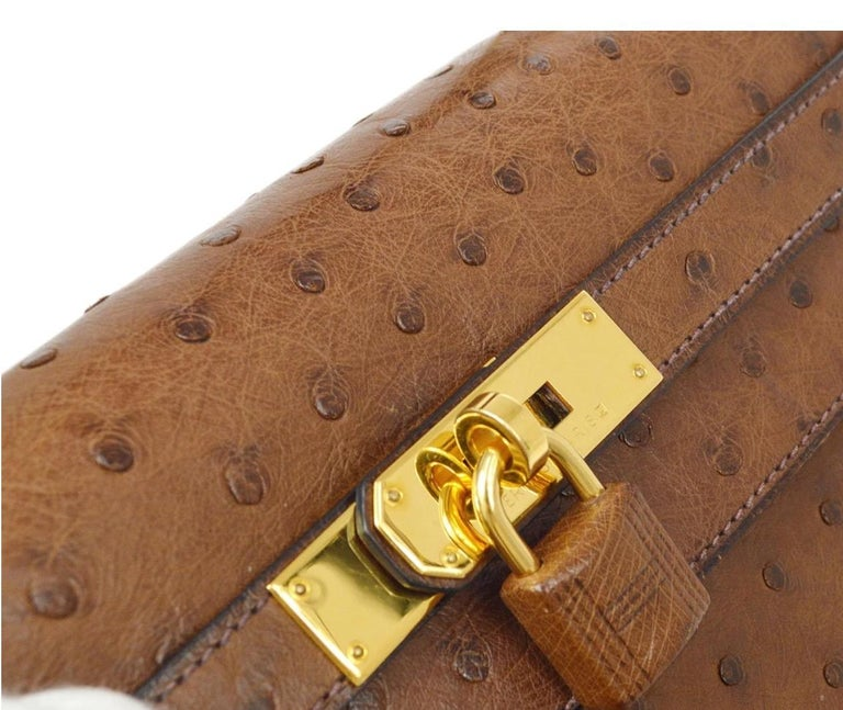 Ostrich Leather trim Gold plated hardware  Leather lining Turn-lock closure  Made in France Handle drop 3.5