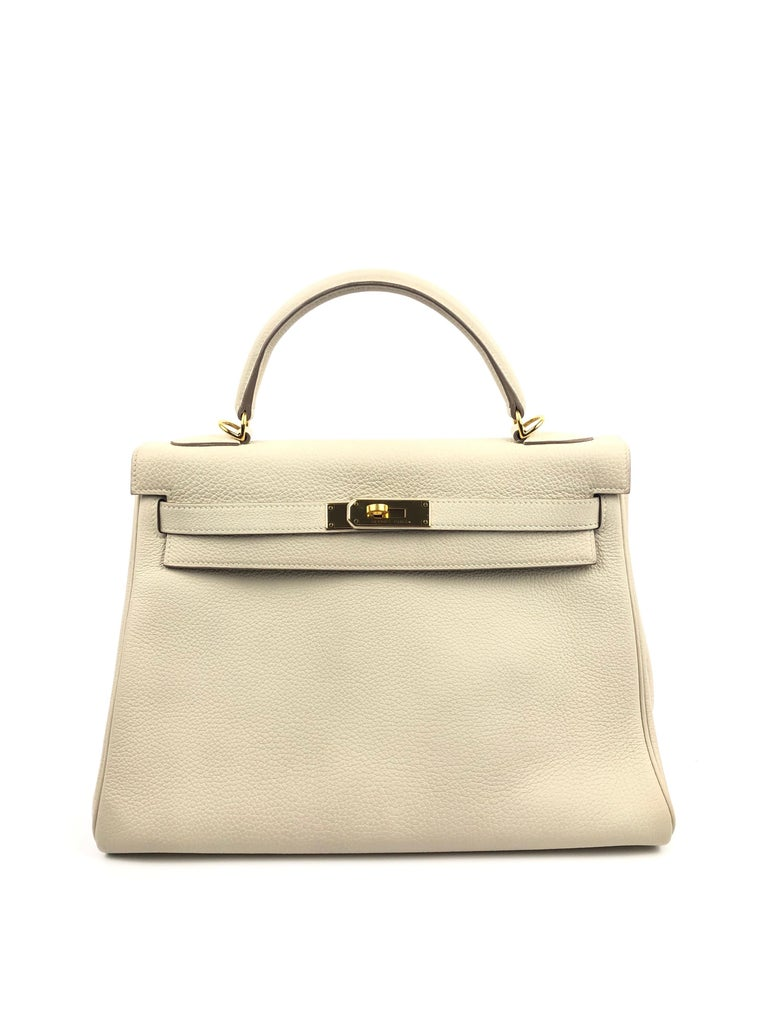 Hermes Kelly 32 Parchemin Beige Togo Gold Hardware. Pristine condition Plastic On Hardware.  Shop with confidence from Lux Addicts. Authenticity guaranteed or money back.