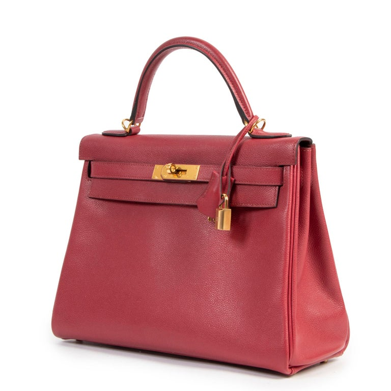 Very good condition  Hermes Kelly 32 Rouge Grenat Veau Evercolor GHW  Renamed after the princess of Monaco, Grace Kelly, the Hermès Kelly is one of most trendy sized and hard-to-get bag. The vibrant Rouge Grenat hue of this one will brighten up your