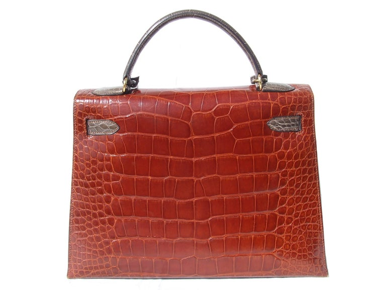 Amazingly Gorgeous Authentic Hermès Vintage Bag  « KELLY »  Limited Edition, in Alligator 3 colorways  Made in France  Stamp T in circle for 1990  Made of Alligator and Golden Hardware  Colorways: Front Ficelle (Beige), Flap and Back in Etrusque