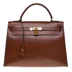 Hermès Kelly 32 sellier handbag in brown Courchevel leather and gold hardware