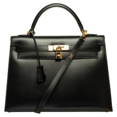 Hermès Kelly 32 sellier handbag with strap in black calf box and gold hardware