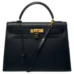 Hermès Kelly 32 sellier handbag with strap in blue calf box and GHW