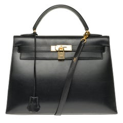 Hermès Kelly 32 sellier with strap in black calfskin with gold hardware!