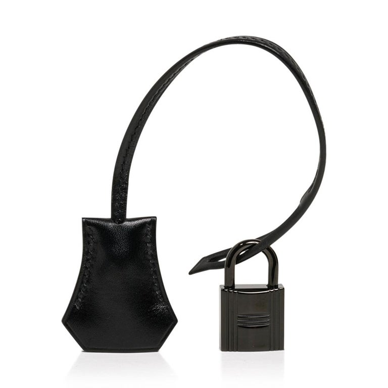 Guaranteed authentic Hermes So Black 32 bag.  This limited edition box leather So Black series was produced for one season only and is a true collectors treasure. Black enamel hardware. This beauty is sure to become your ultimate go to bag! Comes
