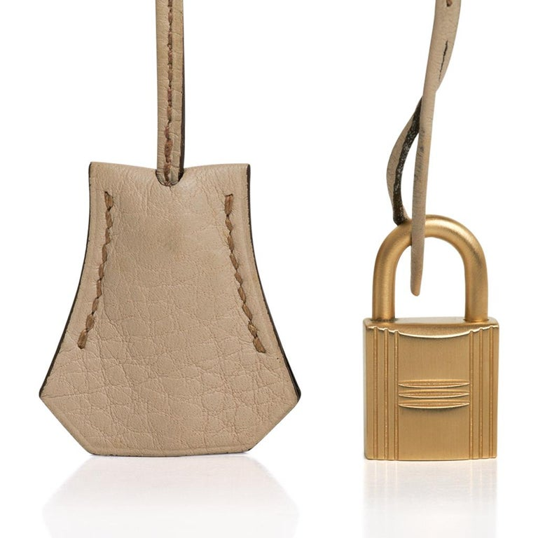 Guaranteed authentic Hermes Kelly 32 bag featured in Tabac Camel, Ebene and Parchemin.  This gorgeous and rare tri color Kelly bag is rich in neutral earth tones. Accentuated with brushed Gold hardware. Tri colour Hermes bags can longer be orderd