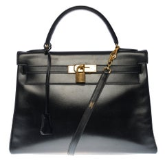 Hermès Kelly 32cm handbag with strap in black calf leather and gold hardware