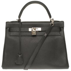 Hermès Kelly 32cm handbag with strap in black togo leather, silver hardware!