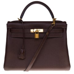 Hermès Kelly 32cm handbag with strap in brown togo leather with gold hardware!