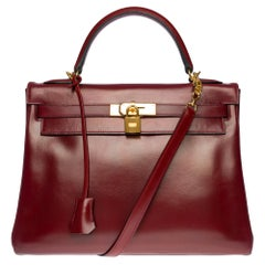 Hermès Kelly 32cm handbag with strap in burgundy calf leather and GHW