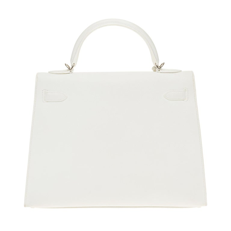 Hermes Kelly Handbag 32 cm in Epsom White leather, Palladium metal trim, white saddle stitches, simple white leather handle, removable white leather shoulder strap handle for carrying hand or shoulder  Closure by flap White leather inner lining, one