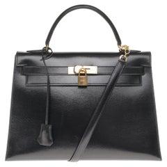 Hermès Kelly 32cm sellier handbag with strap in black calfskin, gold hardware!