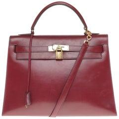 Hermès Kelly 32cm sellier handbag with strap in burgundy calfskin, gold hardware