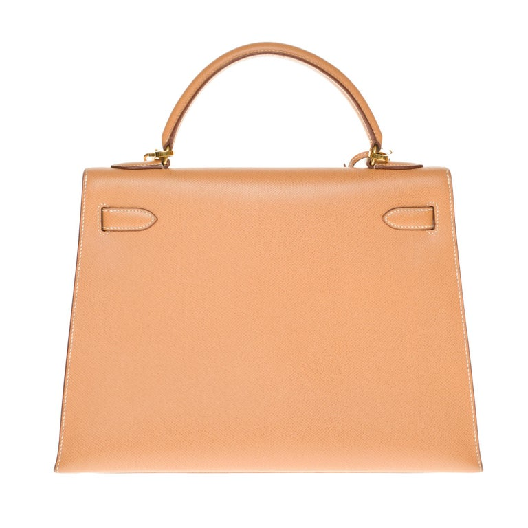 Gorgeous Hermes Kelly sellier 32 cm handbag in Courchevel Gold leather, gold-plated metal trim, single handle in gold courchevel leather, a removable shoulder strap allowing a hand or shoulder support. Closure by flap. Gold leather inner lining, one
