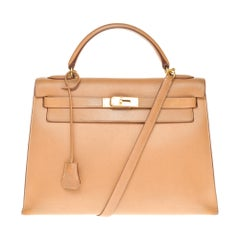 Hermès Kelly 32cm sellier handbag with strap in gold courchevel leather, PHW