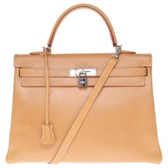 Hermès Kelly 35 handbag in natural calf leather with strap and silver hardware