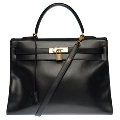 Hermès Kelly 35 retourné handbag with strap in Black Calf leather, GHW