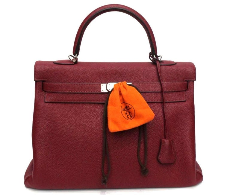 This unique Hermés bag is made from exquisite Togo leather and it is accentuated with luxurious silver hardware. The beautuful shade of red color it is called Ruby and it easy for you to coordinate this bag for any outfit. With an extremely high
