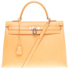 Hermès Kelly 35 sellier in natural calf leather with strap and Gold hardware