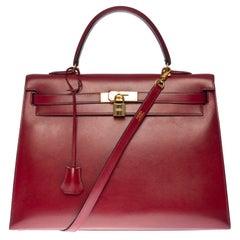 Hermès Kelly 35 sellier strap shoulder bag in burgundy calf leather, GHW