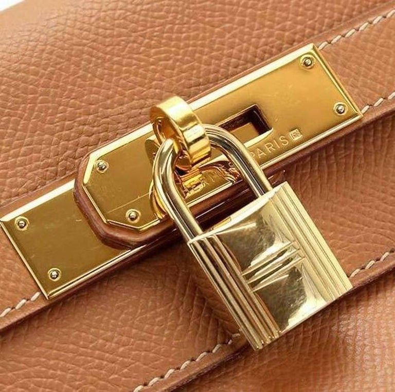 Hermes Kelly 35 Tan Leather Top Handle Satchel Shoulder Tote Bag   Leather Gold tone hardware Date code present Made in France Handle drop 4