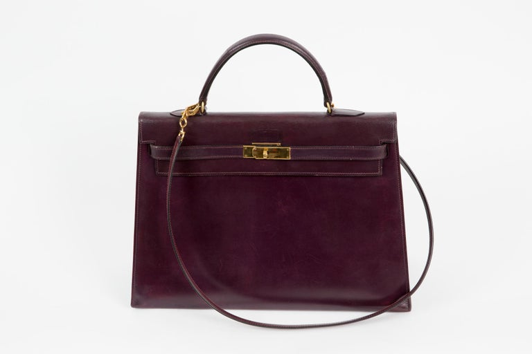 Hermes cherry boxcalf  Kelly tote bag « 35cm » featuring trapeze body, foldover top with twist-lock closure, gold- plated hardware, a top handle and an internal slip pocket. It was a client special order color. Marked Hermès Paris.  A seperated