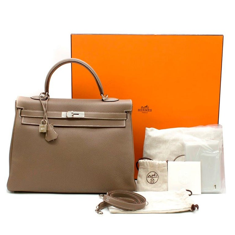 Hermes Kelly 34cm Etoupe Togo leather bag  - Serial Number: [P] - Age (Circa): 2012 - Etoupe-brown, Togo leather  - Top leather handle, detachable shoulder strap  - Dark-brown lacquered edges, signature palladium plated hardware  - Signature