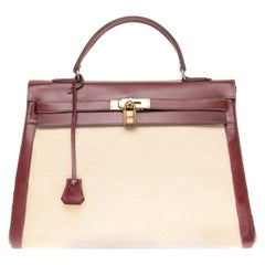 Hermès Kelly 35cm handbag bi-material in beige canvas and burgundy calf leather