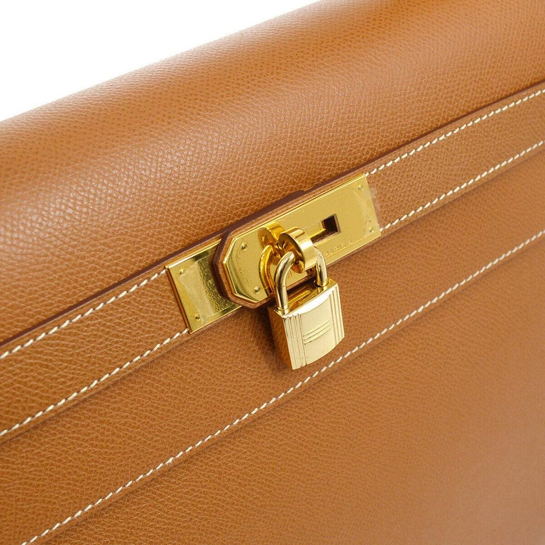 Hermes Kelly 40 Cognac Togo Leather Palladium Top Handle Satchel Shoulder Tote Bag  Leather Gold tone hardware Leather lining Date code present Made in France Handle drop 4